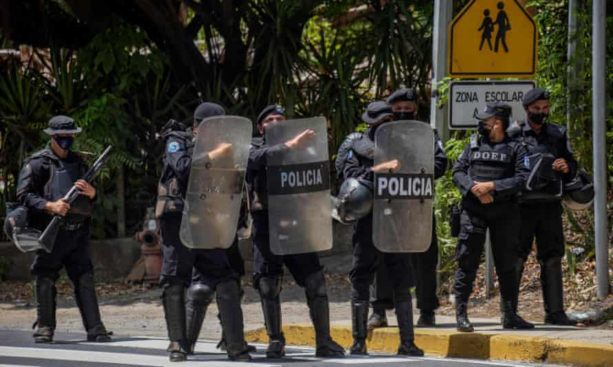 Riot police secure the perimeter of the home of Cristiana Chamorro in Managua on 2 June.
