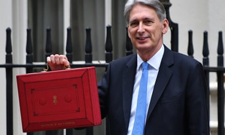 Philip Hammond holds the red case as he departs 11 Downing Street to deliver his budget to parliament.