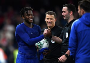 Michy Batshuayi of Chelsea collects the match ball.