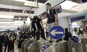 Protesters set up barriers inside the Yuen Long metro station