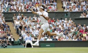 A leaping Federer blasts the ball back to Raonic.