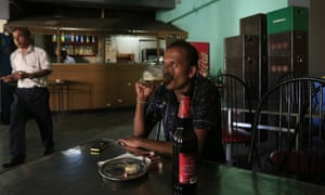 A Sri Lankan man drinks beer at a bar in Colombo