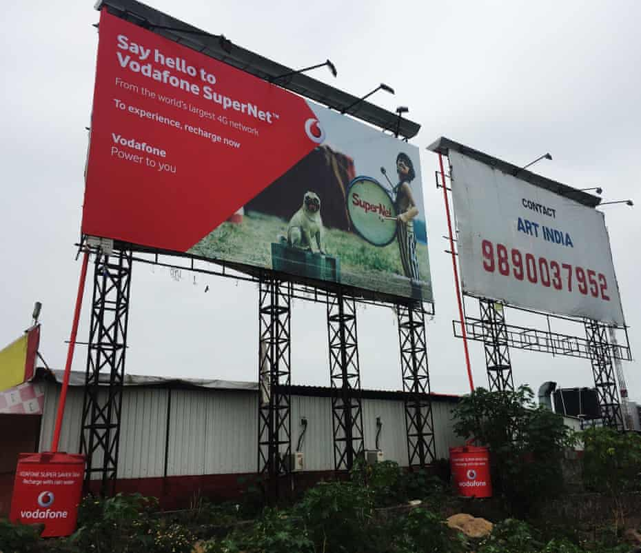 Vodafone billboards on the New Airport road near Pune