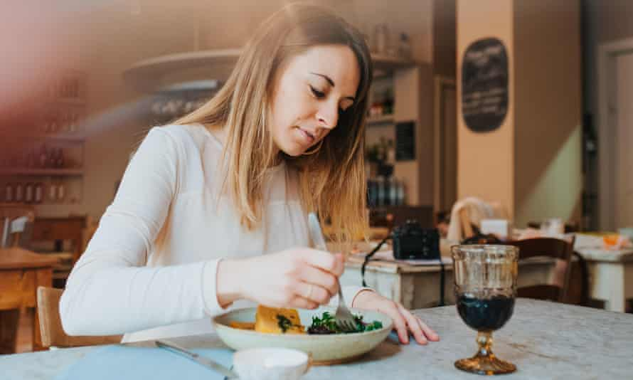 Woman having vegan meal in restaurant