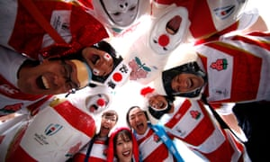 Japan fans pose for a picture before the Rugby World Cup quarter-final against South Africa