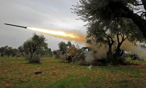 Members of Syria's opposition National Liberation Front fire rockets at government forces in the village of Talhiyeh in north-eastern Idlib province.