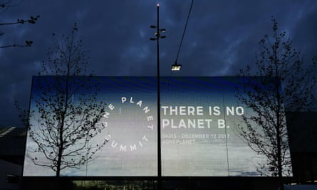 A screen reading 'There is no planet B,' outside the One Planet Summit in Paris