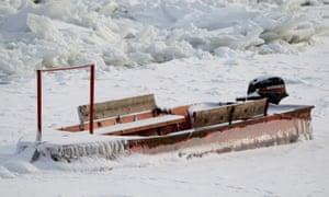 Boat stuck in the frozen river Danube in Belgrade, Serbia.