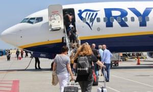 Passengers boarding a Ryanair flight in Athens