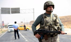 A Turkish soldier stands guard at a checkpoint between Mardin and Cizre near the south-eastern town of Midyat.