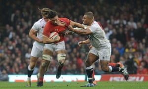 Wales' Josh Navidi is tackled by England's Kyle Sinckler at the Principality Stadium.