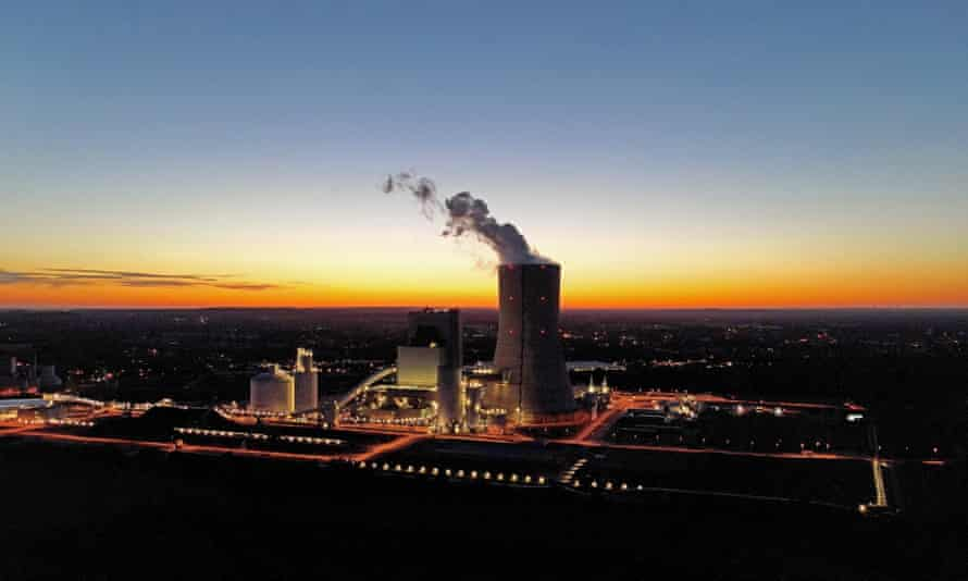 Drone shut of coal-fired power plant operating in twilight.