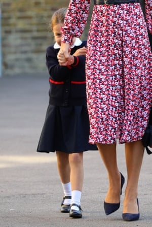 London, UK: Princess Charlotte hides behind her mother, the Duchess of Cambridge, as she arrives for her first day at Thomas's Battersea school in south-west London