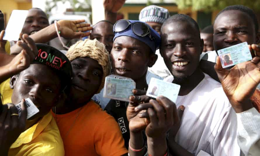 Menwait in line to register to vote during elections in Kano in March 2015.