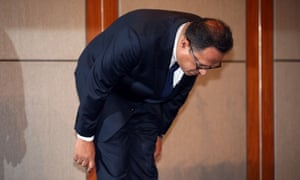 Atar Safdar bows during a press conference.