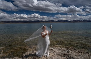 Tibet Autonomous Region, China A woman has her wedding photos taken on the shore Namtso lake during a government organised visit for journalists