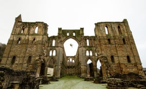 A stonemason James Preston abseils from Rievaulx Abbey in North Yorkshire, England