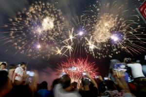 Filipinos watch as fireworks light up the sky to welcome the New Year Monday, Jan. 1, 2018 at the seaside Mall of Asia in suburban Pasay city south of Manila