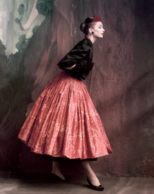 Suzy Parker, wears Givenchy's Chinese swinging lacquer-printed skirt with lace petticoat and quilted satin jacket in Vogue, 1953