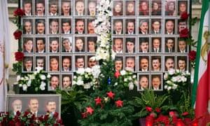 A memorial shows members of the Mujahedin of Iran (MEK) reportedly killed in previous attacks.