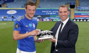 Jamie Vardy of Leicester City is presented with a silver fox by Leicester City Manager Brendan Rodgers, to commemorate scoring 100 Premier League goals.