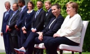 Angela Merkel sits alongside the Danish prime minister, Mette Frederiksen
