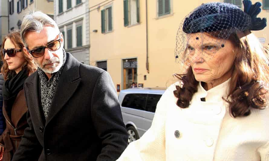 Walter and Jennifer Olsen parents of Ashley Olsen, attend their daughter's funeral in Florence.