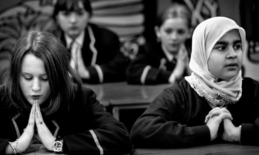 Prayers during a religious education class at Notre Dame Roman Catholic School, Glasgow.