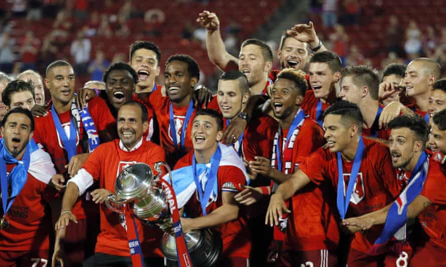 FC Dallas, who have a host of Latino players and coach from Colombia, show off their US Open Cup trophy after beating New England Revolution.