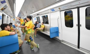 Olympic volunteers take the newly opened metro line 4 in Rio de Janeiro, 1 August 2016.