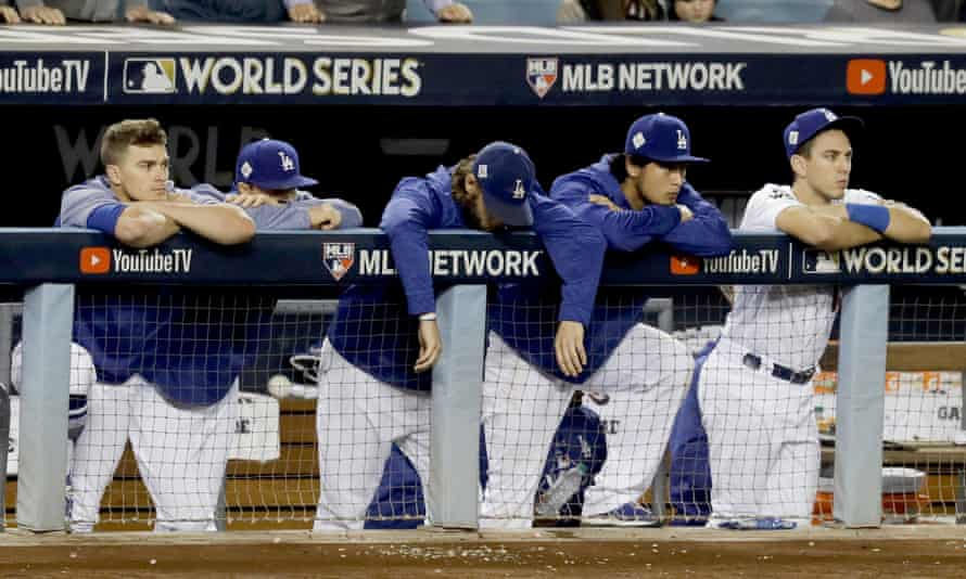 Members of the Los Angeles Dodgers watch as the Houston Astros celebrate their win in the 2017 World Series