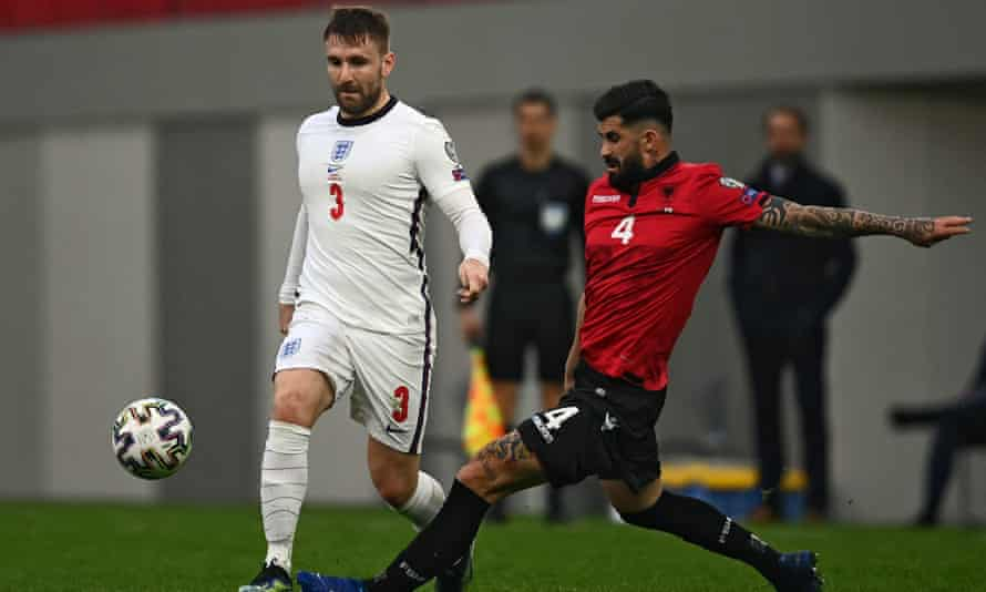 Luke Shaw (left) fights for the ball with Albania's Elseid Hisaj during the World Cup qualifier in Tirana.