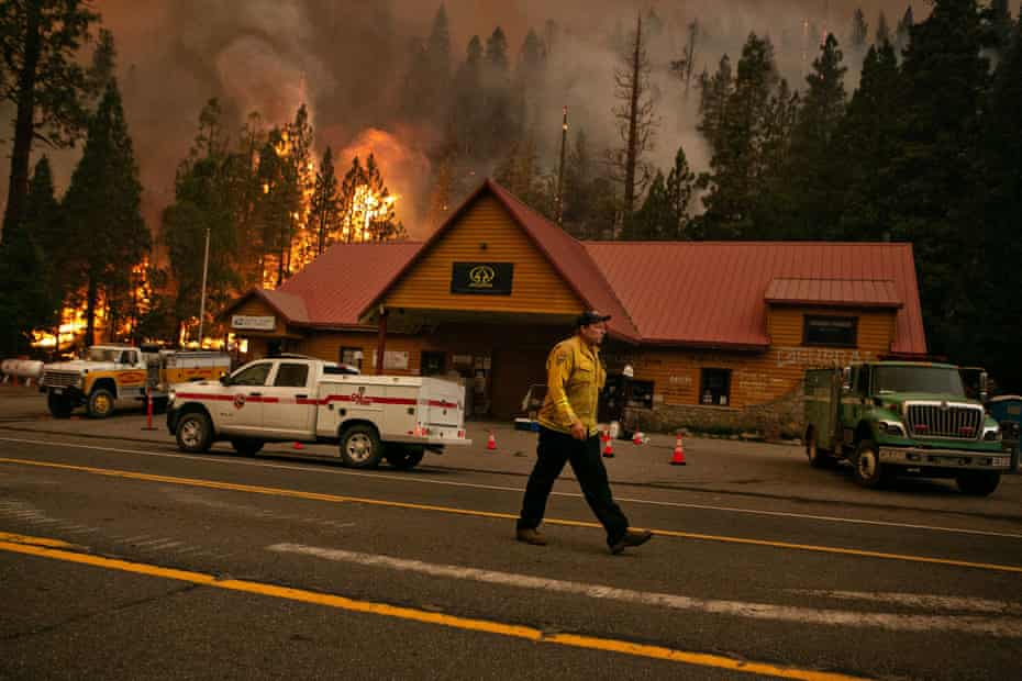 Firefighters work to protect the Strawberry Station general store on Highway 50 in Strawberry, California.