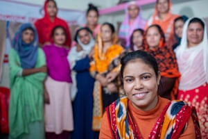 Josna, 37, leader of the Hatkhola Women Squad, holds a meeting at the Community Disaster Management Committee Center.