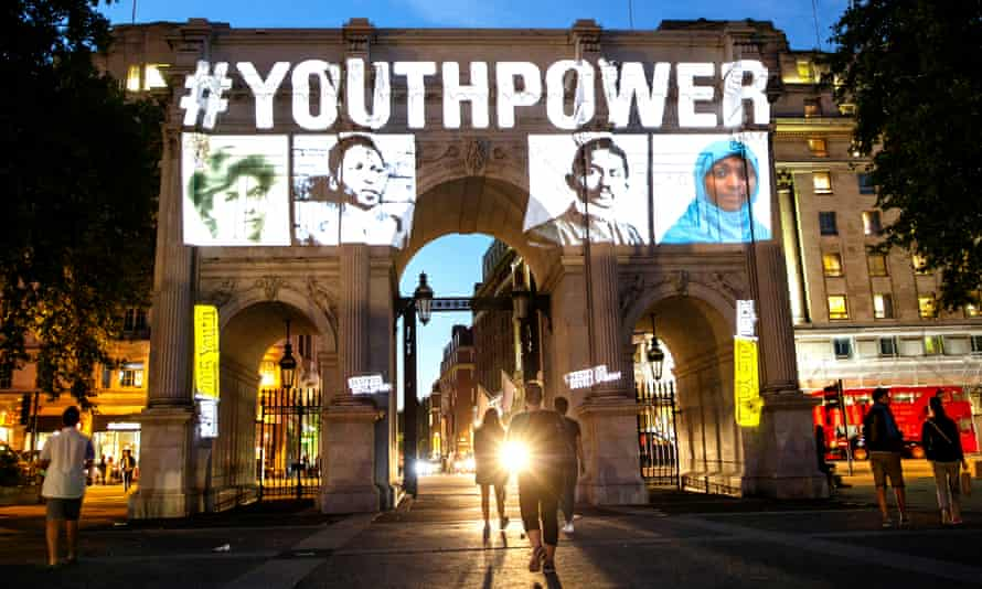 Images of inspiring figures in their youth projected by Restless Development on to Marble Arch, London.