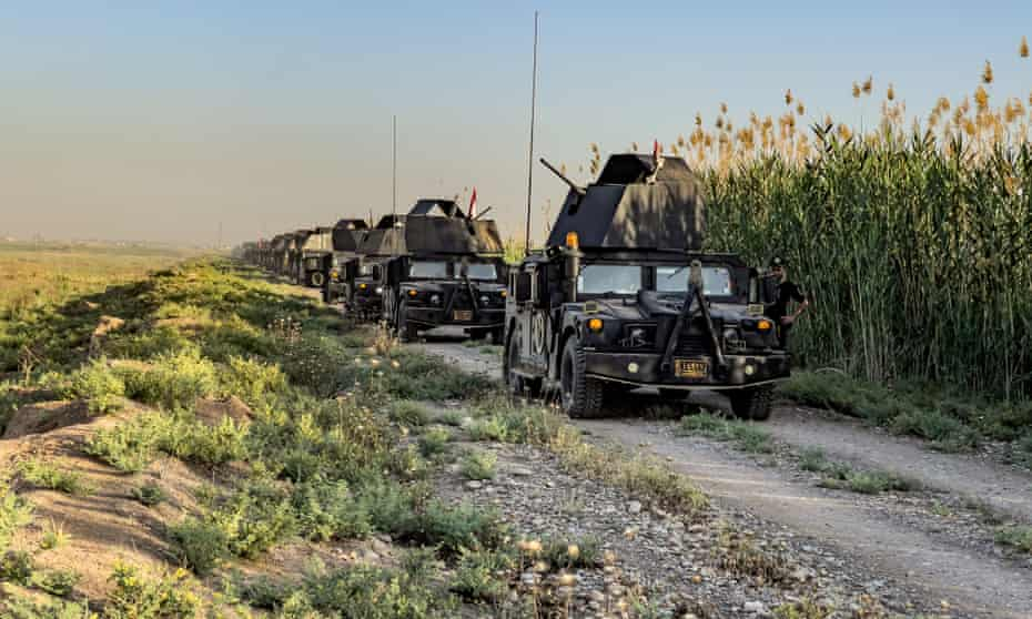 An Isof convoy in the countryside south of Kirkuk.