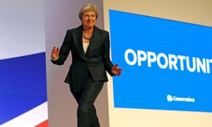 Theresa May arrives on stage dancing to Abba's Dancing Queen before delivering her keynote address on the final day of the 2018 Conservative party conference in Birmingham.