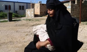Shamima Begum, holding her baby son, in a Syrian refugee camp