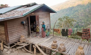 A Chin family living in their bamboo home in the hills of Mindat, Myanmar.