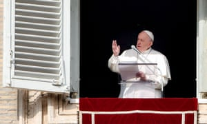 Pope Francis addresses attendees from the window of the Apostolic palace during the weekly Angelus prayer on Sunday.