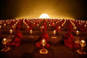 Thousands of Buddhist monks chant during a lantern lighting to celebrate Makha Bucha day at Dhammakaya temple.