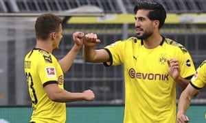 Emre Can of Borussia Dortmund (right) celebrates after opening the scoring.