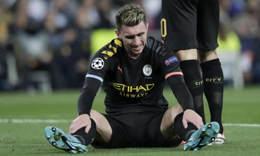 Manchester City's Aymeric Laporte sits injured on the pitch at Real Madrid.