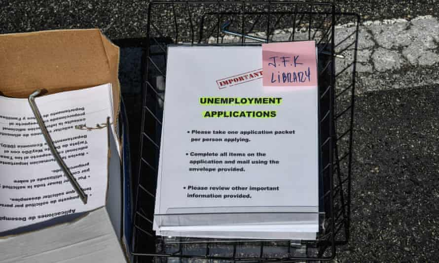 Paper unemployment forms are distributed at a drive-thru collection point in Hialeah, Florida, on 8 April.