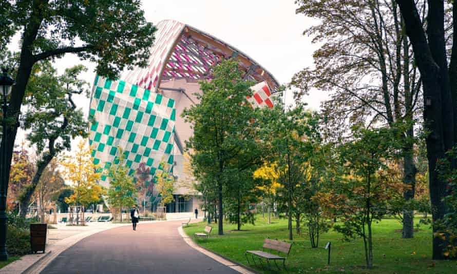 Museum of modern art Foundation Louis Vuitton, view from the Park with walking people, early autumn
