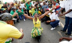 Supporters of presidential candidate Cyril Ramaphosa sing and dance at the gates of the Nasrec Expo Centre, where the 54th National Conference of the ruling ANC party is taking place, in Johannesburg