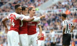 Pierre-Emerick Aubameyang, Mesut Özil and Héctor Bellerín celebrate after the Arsenal No 10 put the game beyond Newcastle's reach.