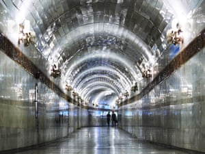 A shimmering corridor linking two stations