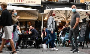 People sit on a cafe's terrace in Lille, northern France.
