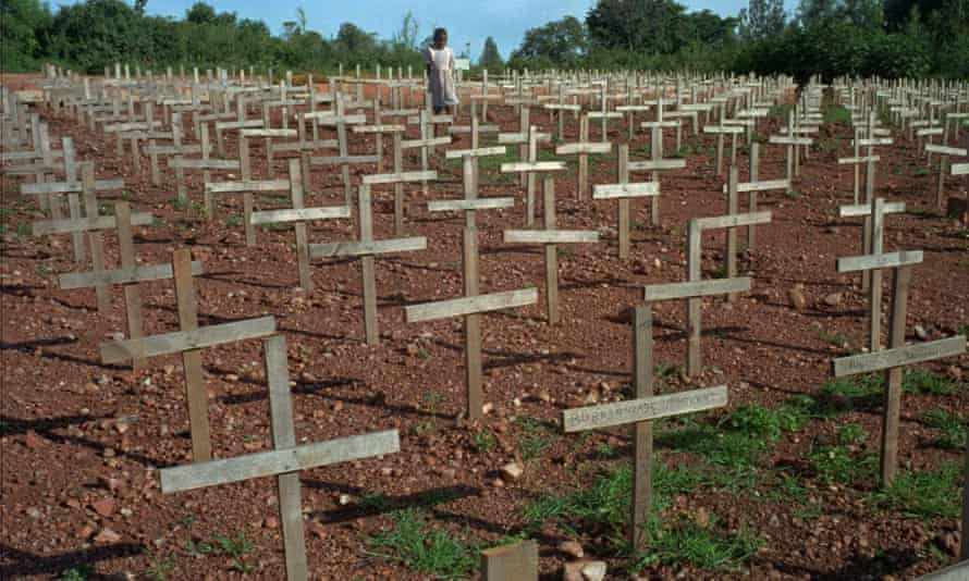 A young girl walks through Nyaza cemetery outside Kigali, Rwanda, where thousands of victims of the 1994 genocide are buried.